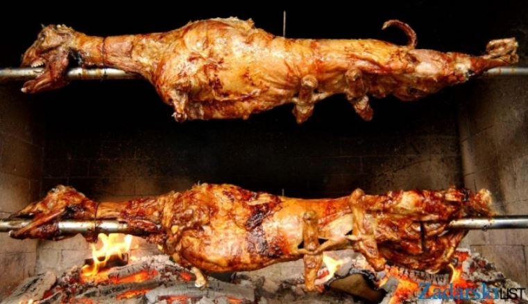 Must eat in Croatia. Lamb placed on the skewer baking on live coals.