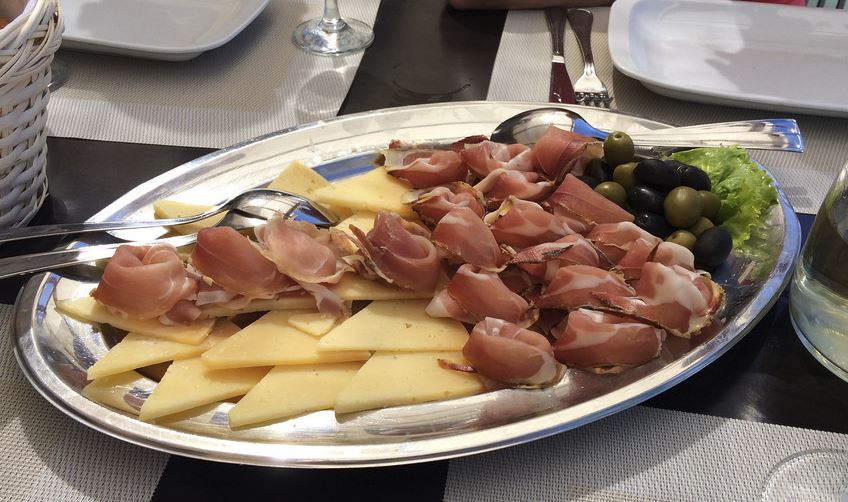 Pag cheese and prosciutto sliced in tray. Must eat in Croatia
