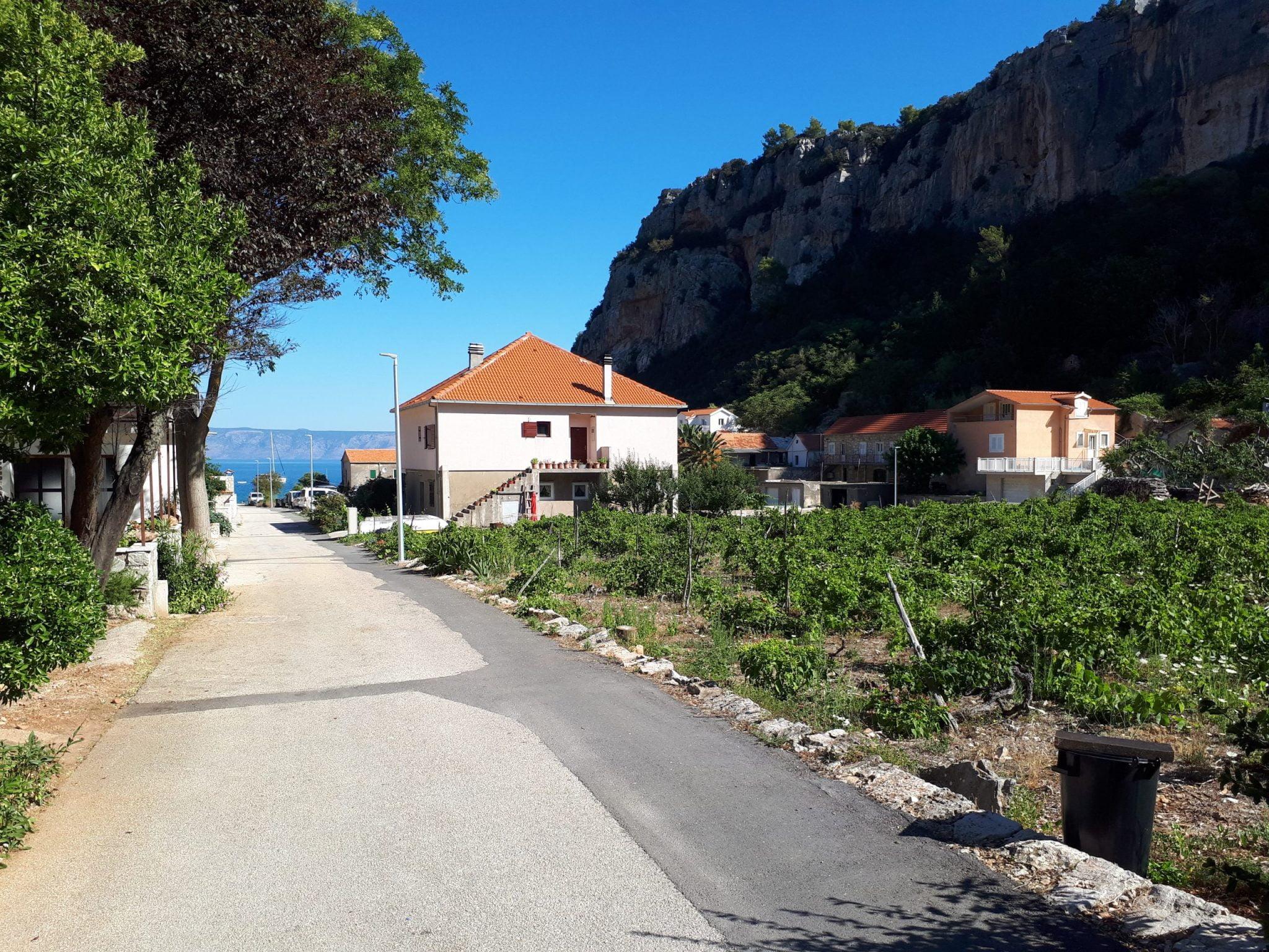 Vela Stiniva surrounded by rocks